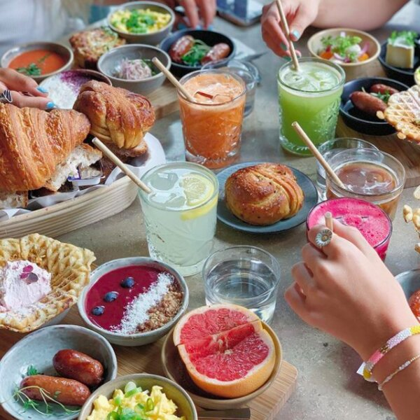 Brunch with fruit, bread and juice