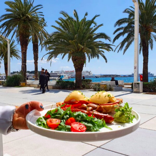 eating breakfast at the waterfront in split