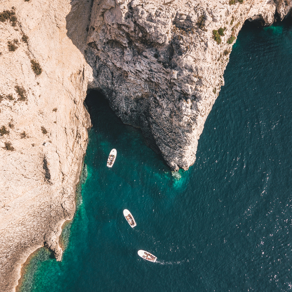 boats entering the blue cave in croatia