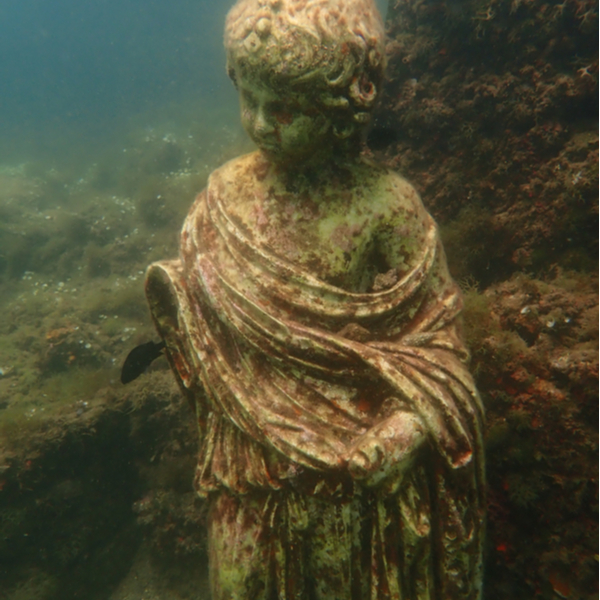 statue underwater in the lost city of Baiae