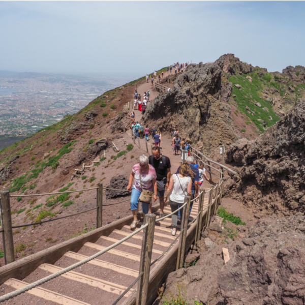 people climbing to the crater of Vesuvius volcano