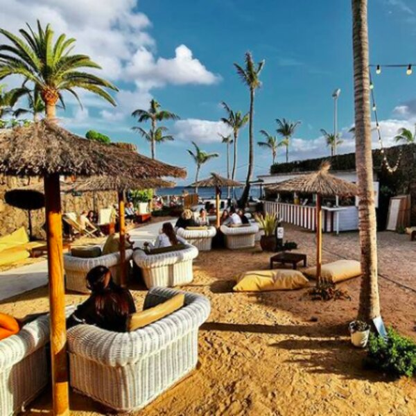 people drinking at beach club in lanzarote