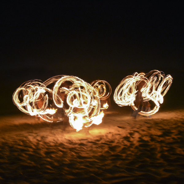 fire dancing show being performed on nadi in fiji