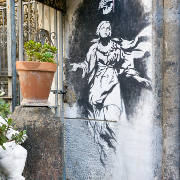 painting by banksy on a wall in naples