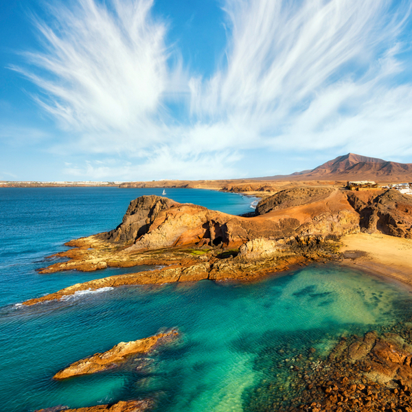 lanzarote beach with turquoise waters and golden sand