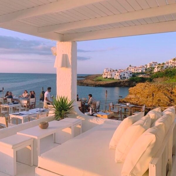 menorca beach club at sunset with sea view