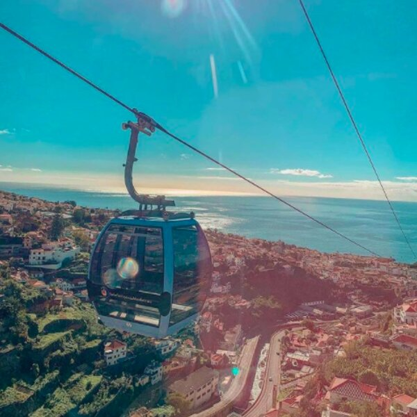 riding the cable car in madeira with a view over the city