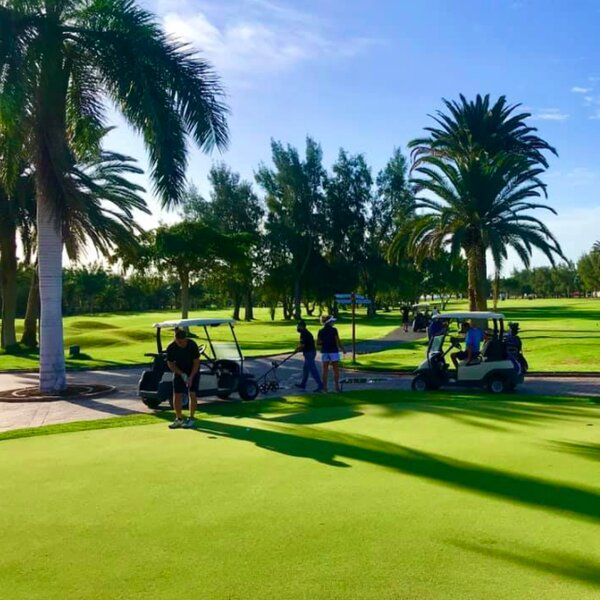 people on golf buggies at golf course in gran canaria