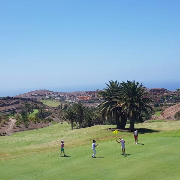 people playing round of golf on the old course in gran canaria