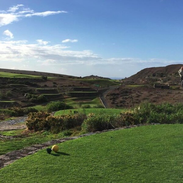 gran canaria golf course with mountains and sea view