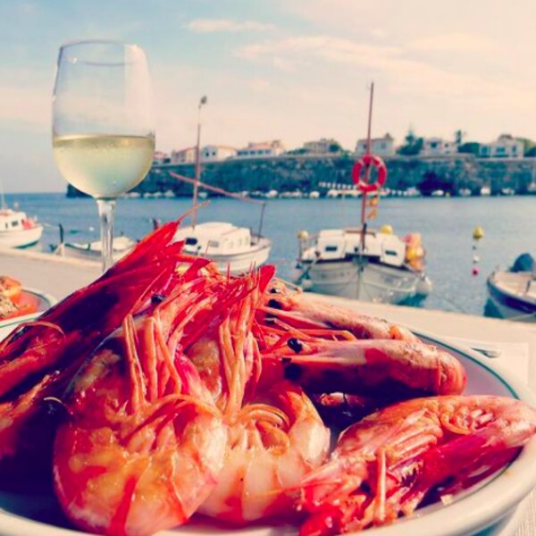 eating seafood with sea view in menorca