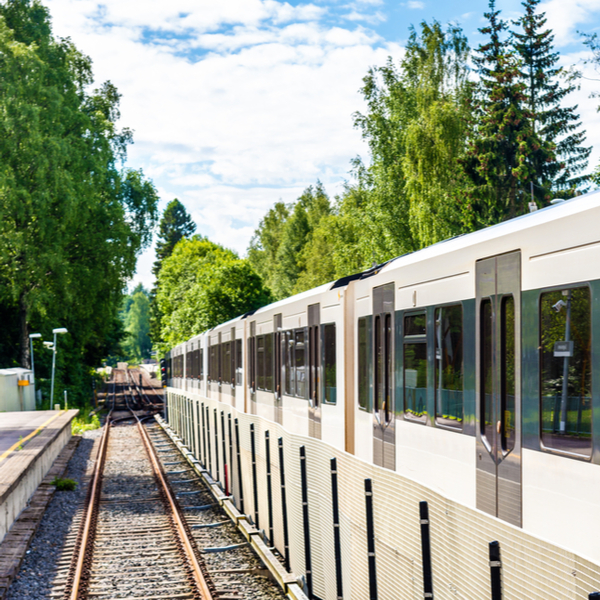 train surrounded by trees at Sognsvann metro Station in oslo