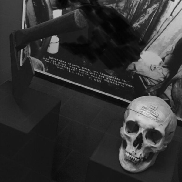 axe and skeleton in exhibit at vienna crime museum