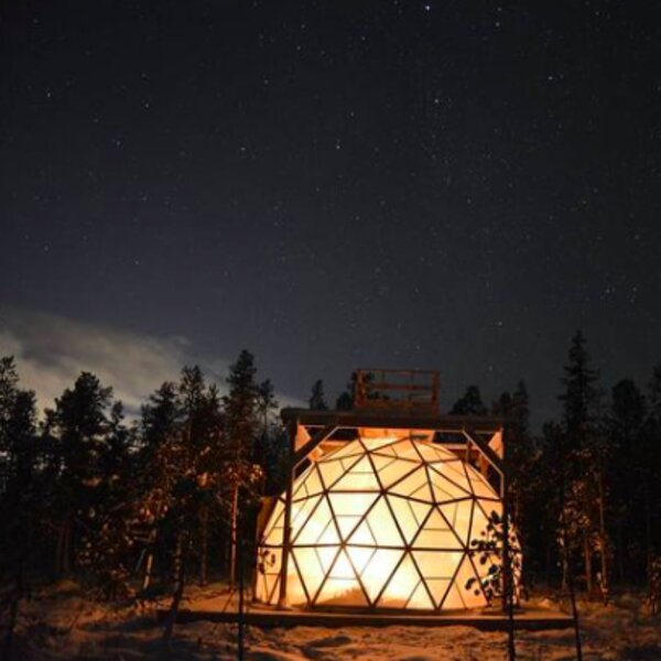 igloo under the northern lights in lapland