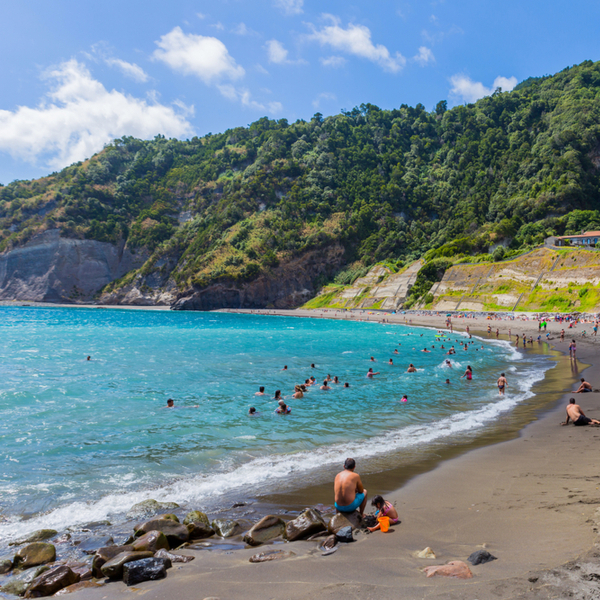 people swimming in the sea at beach in azores