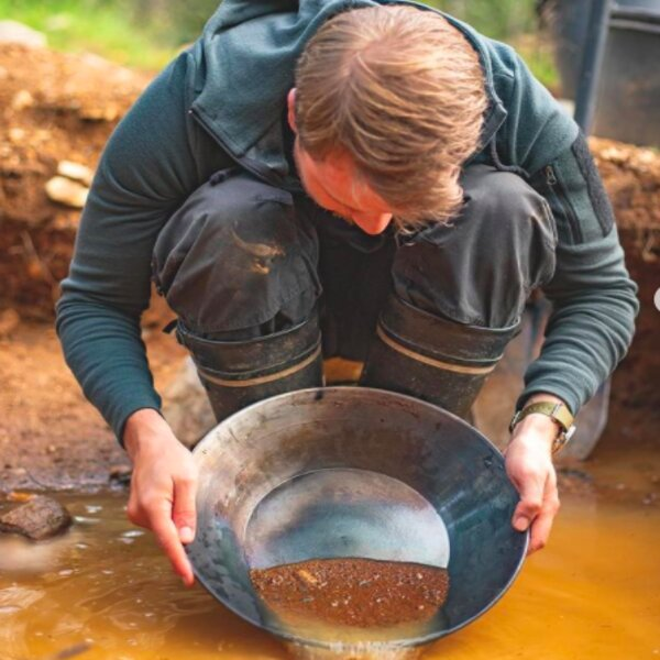 man panning for gold in lapland