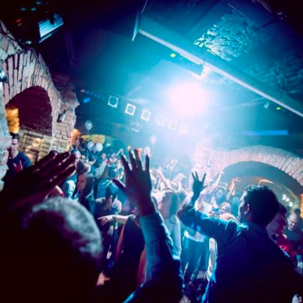people dancing at a club in riga