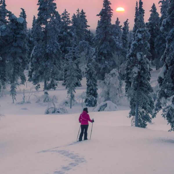 person skiing in resort in lapland