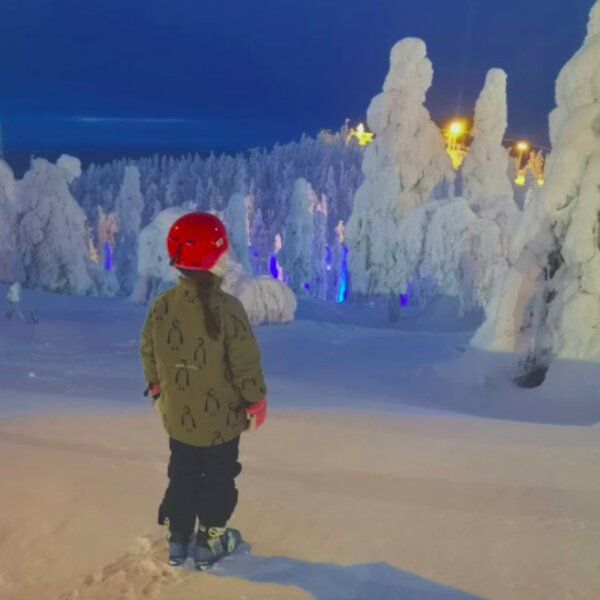 child on snowy slope at a ski resort in lapland