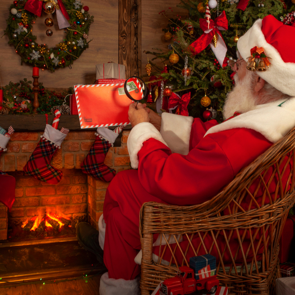 santa reading letters at his cottage in ruka, lapland