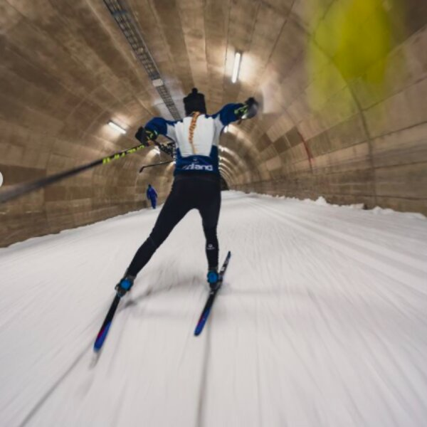 skiing through a tunnel in lapland