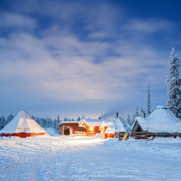 cabins covered in snow at lapland in winter