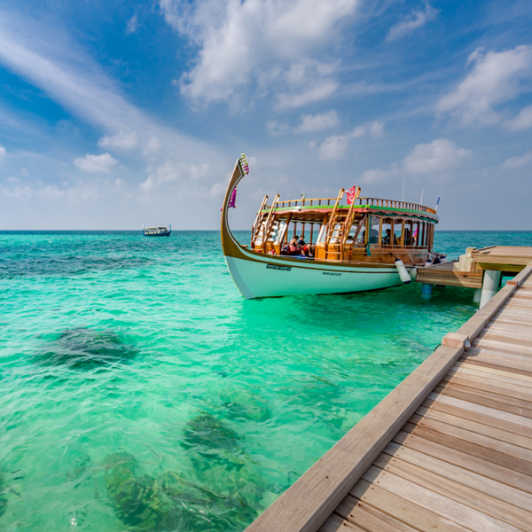 people waiting for a dhoni ride in maldives